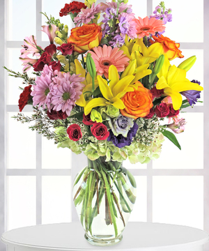 Fresh cut floral arrangement bursting with bright colors